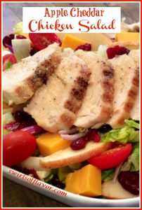 sliced chicken with apples and cranberries for a main dish salad with text overlay