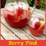 Berry Pink Lemonade Prosecco Punch is flavored with puckeringraspberry lemonade and bubbly Prosecco and topped off with the sweet bursts of fresh berries! Perfect for Mother's Day or any get together! punch | Prosecco | berries | strawberry | raspberry | punch | Mother's Day | picnic | summer | drinks | lemonade | #swirlsofflavor | easy recipe