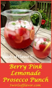 Berry Pink Lemonade Prosecco Punch is flavored with puckering raspberry lemonade and bubbly Prosecco and topped off with the sweet bursts of fresh berries! Perfect for Mother's Day or any get together! punch | Prosecco | berries | strawberry | raspberry | punch | Mother's Day | picnic | summer | drinks | lemonade | #swirlsofflavor | easy recipe