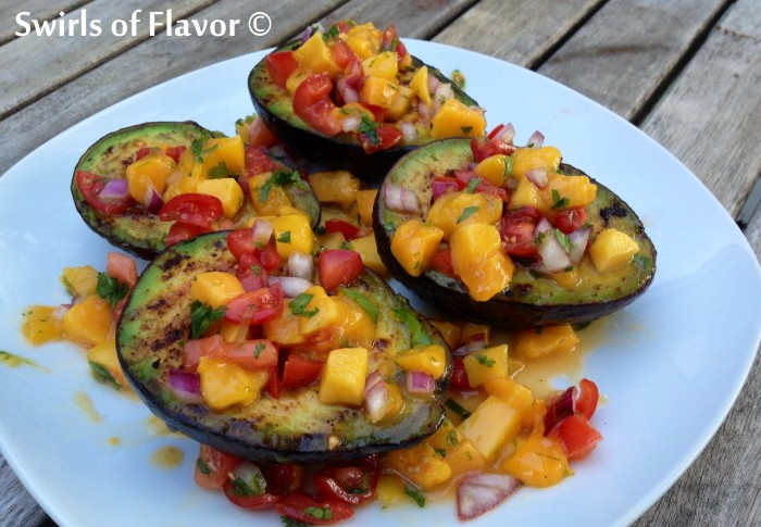Gilled Avocados With Mango Salsa taste divine when you combine the creaminess of avocado with the sweet and tangy flavors of a homemade mango salsa! avocado | salsa | homemade | grilled | mango | appetizer | side dish | recipe