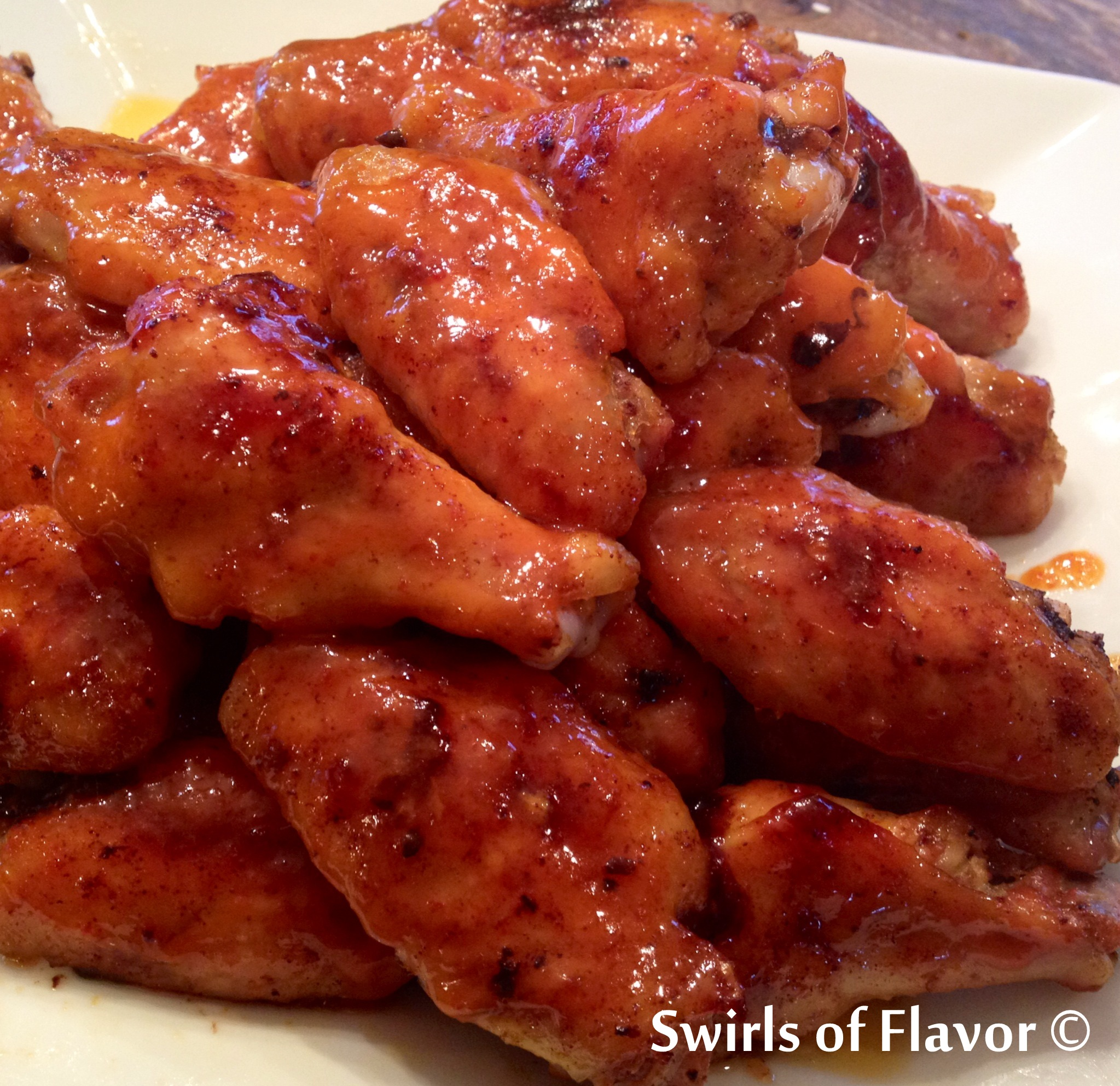 Sriracha Honey Chicken Wings - Swirls of Flavor