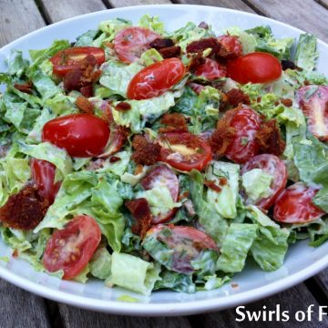 Lettuce tossed in creamy dressing with bacon and tomato