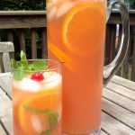 The Belmont Breeze Punch combines the flavors of cranberry and orange juices with Bourbon and the fizz of lemon lime soda making it both refreshing and mouthwatering! Bourbon | alcohol | drinks | cocktails | adult beverage | juice | soda | Belmont Stakes