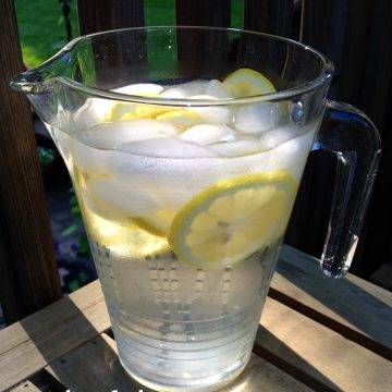 The Benefits of Drinking Water are many! Add lemon and the benefits increase. Check out how much water you should be drinking and the increased benefits of adding lemon! #lemon #water #benefitsofwater #benefitsoflemonwater #keephydrated #swirlsofflavor