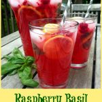 Raspberry Basil Lemonade in two glasses and a pitcher