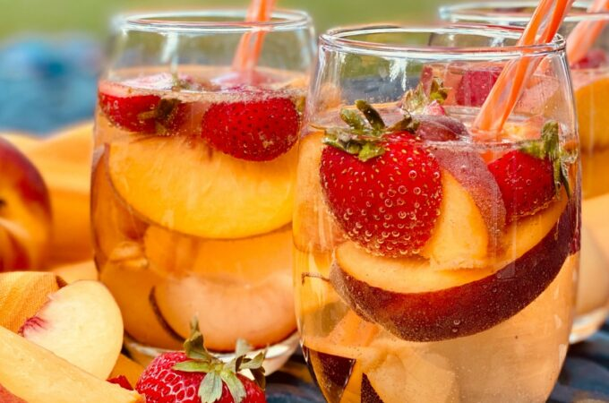 glasses of sangria with fresh fruit and straws