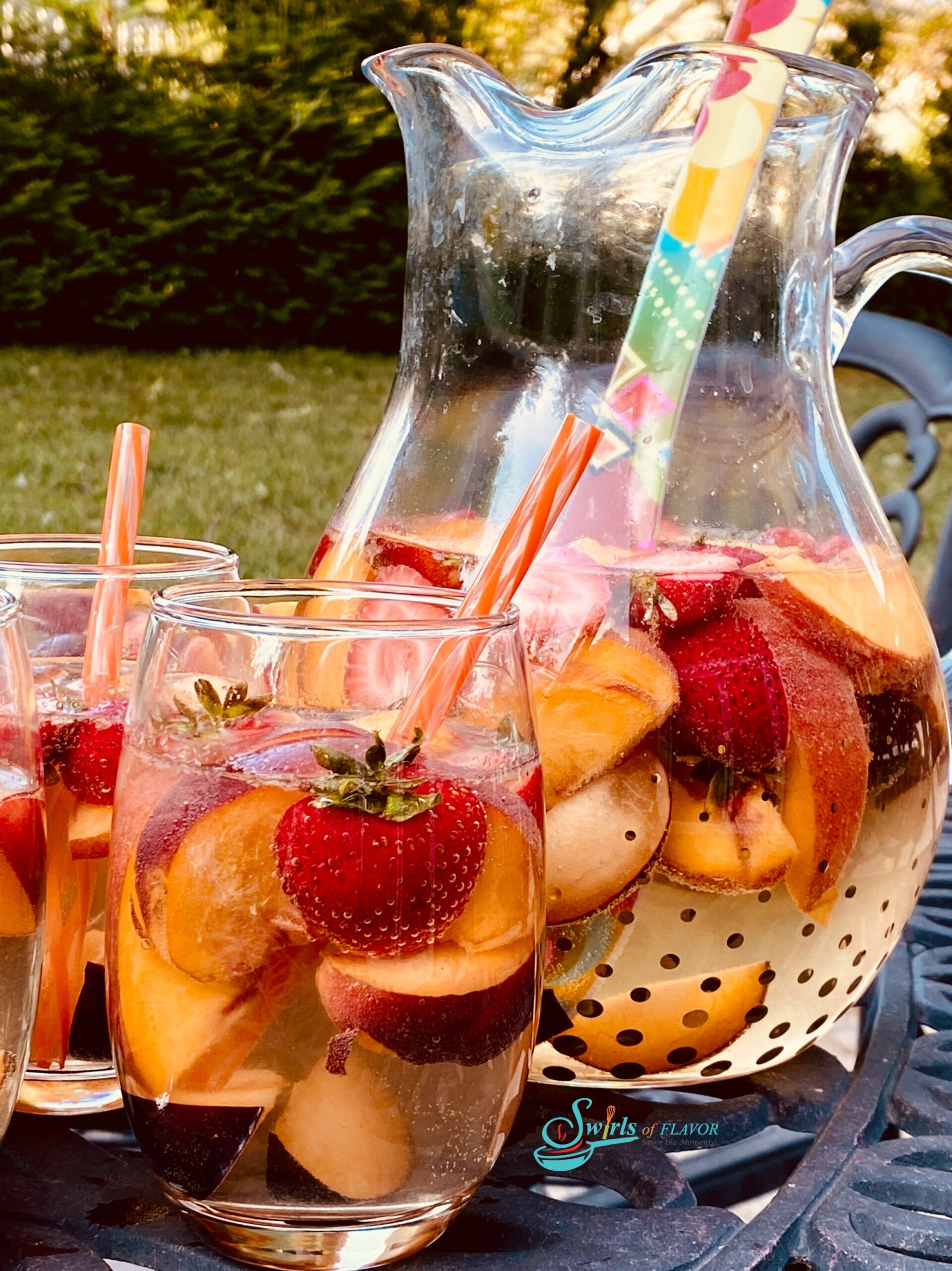 Sangria with fresh fruit, glasses and pitcher