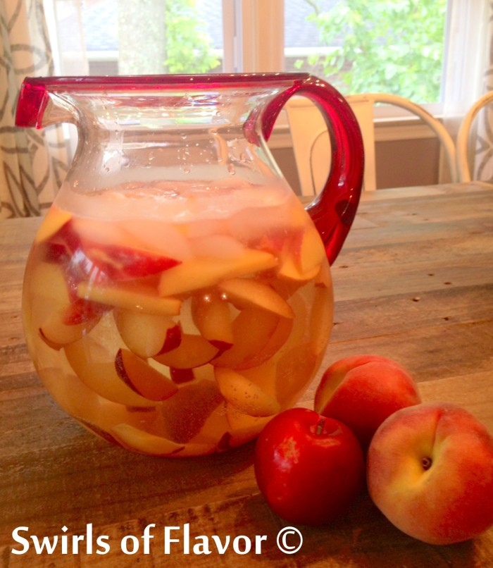Peachy Plum Sangria is a white sangria filled with juicy sweet peaches and luscious plums and you'll savor every sip of this easy summer drink recipe! easy recipe | cocktail | peach | plum | farmers market | summer fruit | stone fruit | happy hour | #swirsoffavor