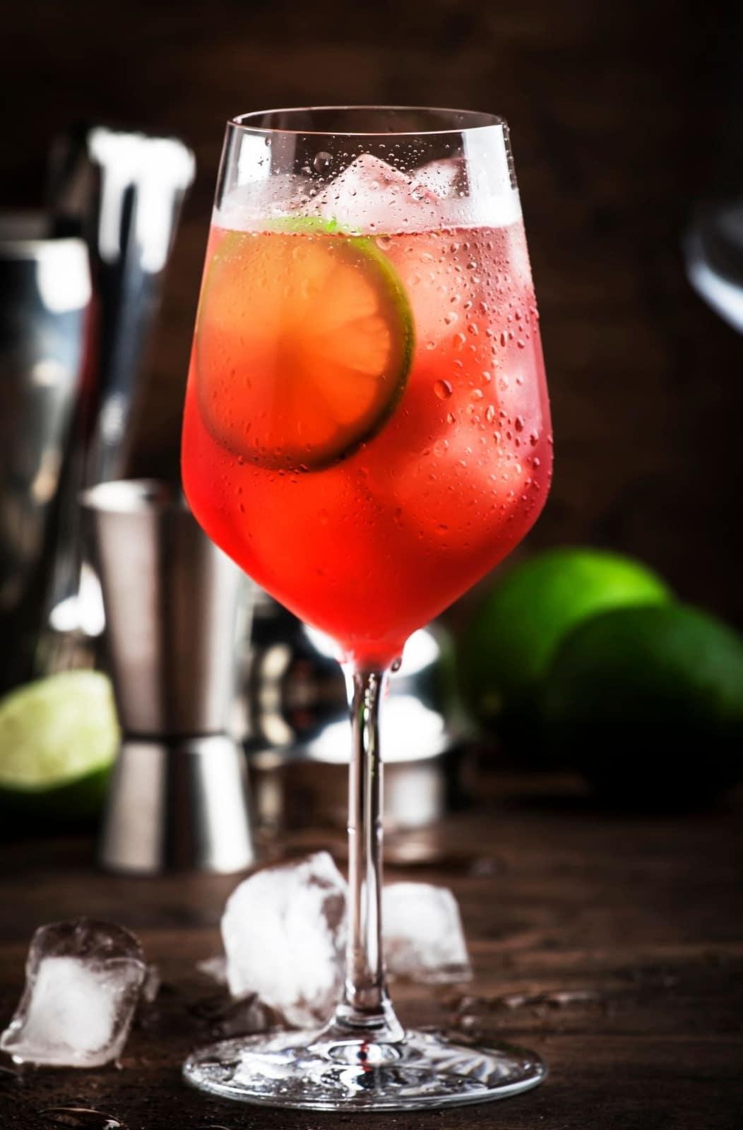 Campari tonic in a wine glass with stem