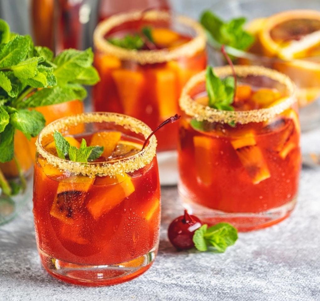 glasses of Capari tonics with sugar rims and fresh mint