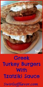 Greek Turkey Burgers with feta cheese, oregano and a pinch of red pepper flakes pair perfectly with the cool cucumber yogurt of the Tzatziki Sauce! turkey burger | Greek | cheese | feta cheese | yogurt sauce | cucumber | grilling