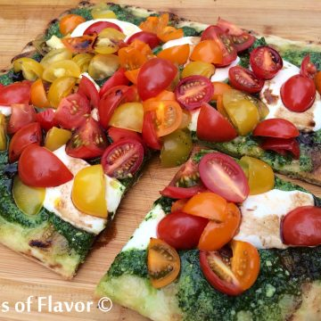 Grilled pizza crust topped with Kale Pesto, fresh mozzarella, gorgeous juicy heirloom tomatoes and drizzled with balsamic vinegar will delight your taste buds and make you wish summer will never end!