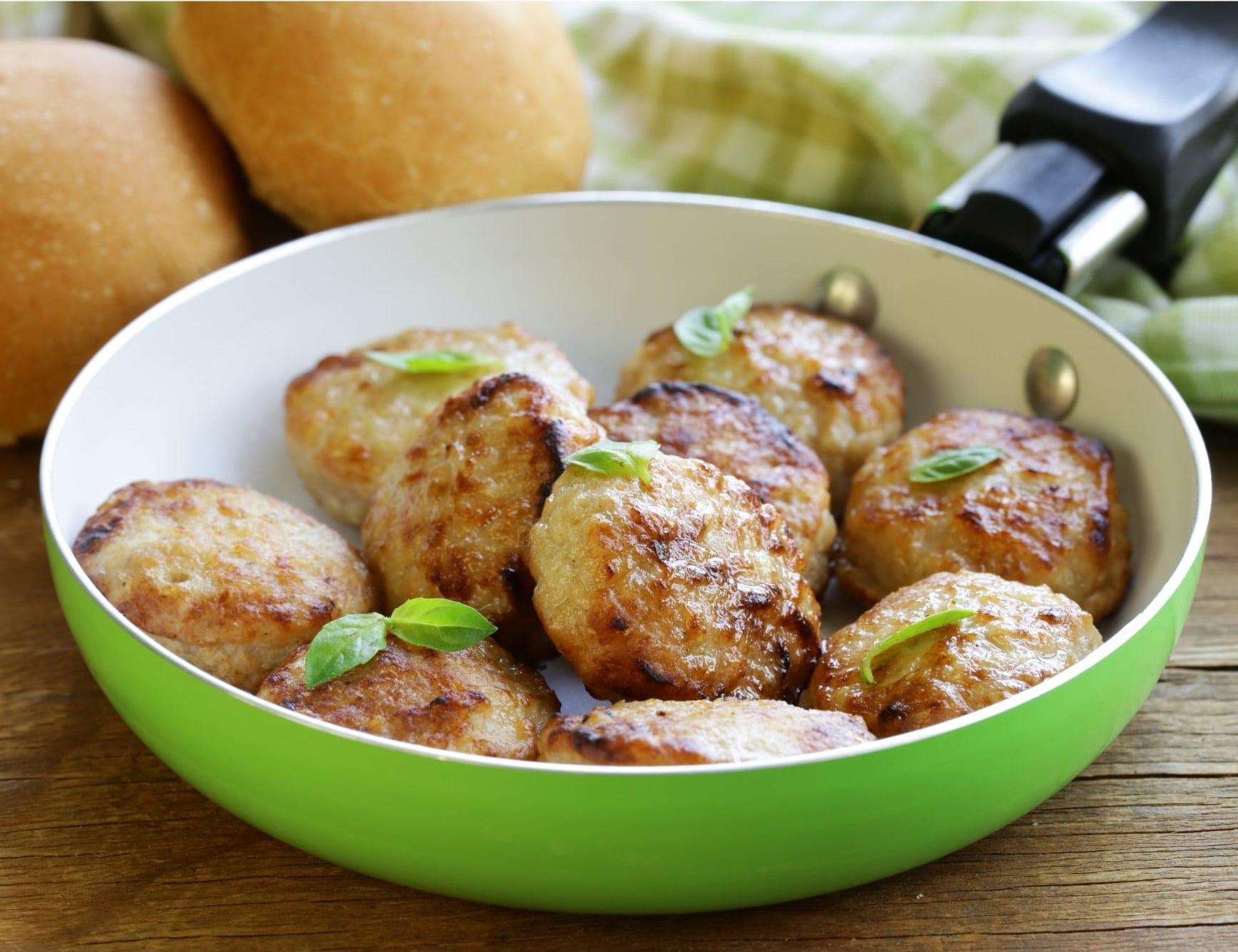turkey meatballs in a green skillet