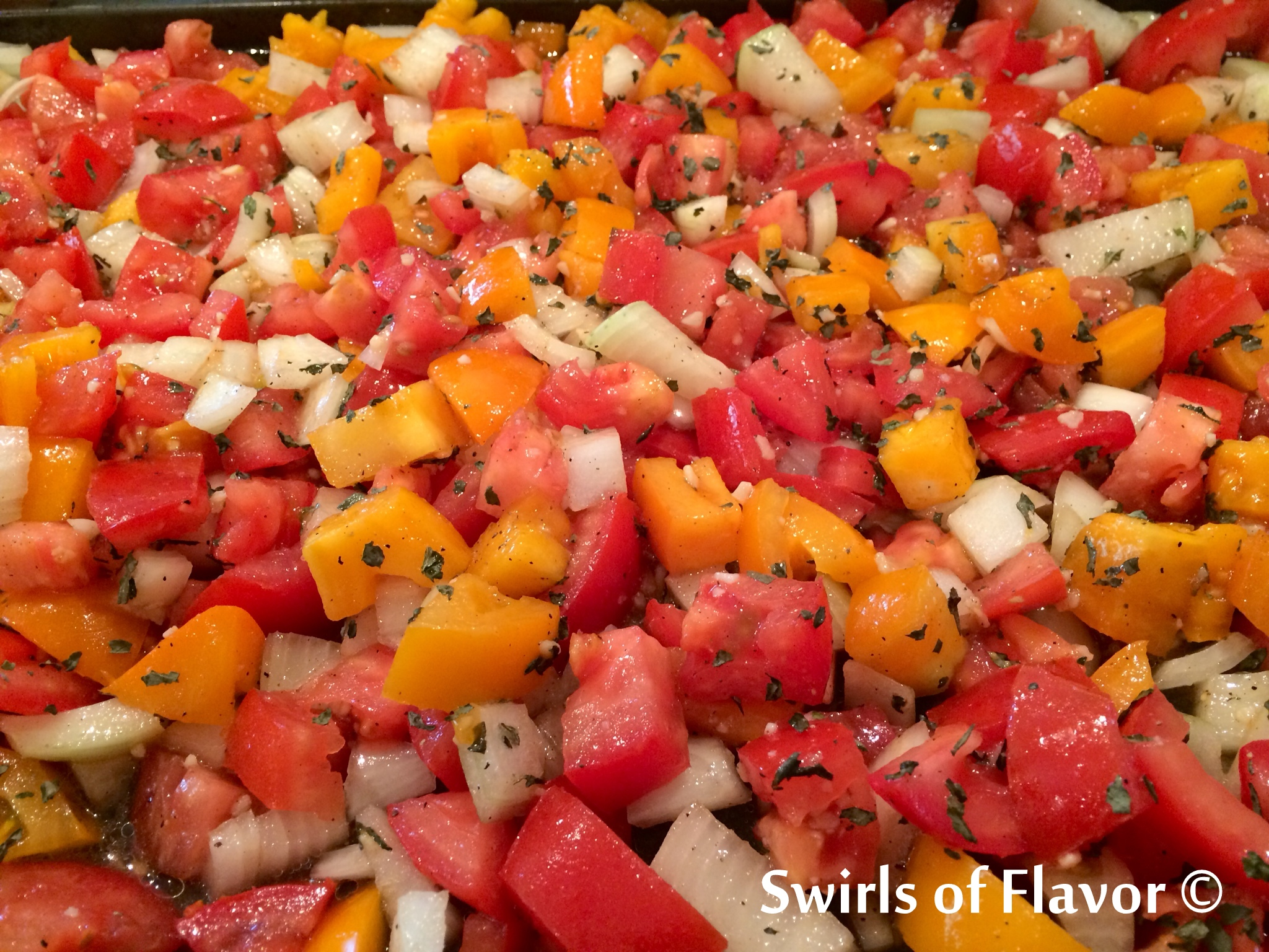chopped rred and yellow plum tomatoes with onion and seasonings