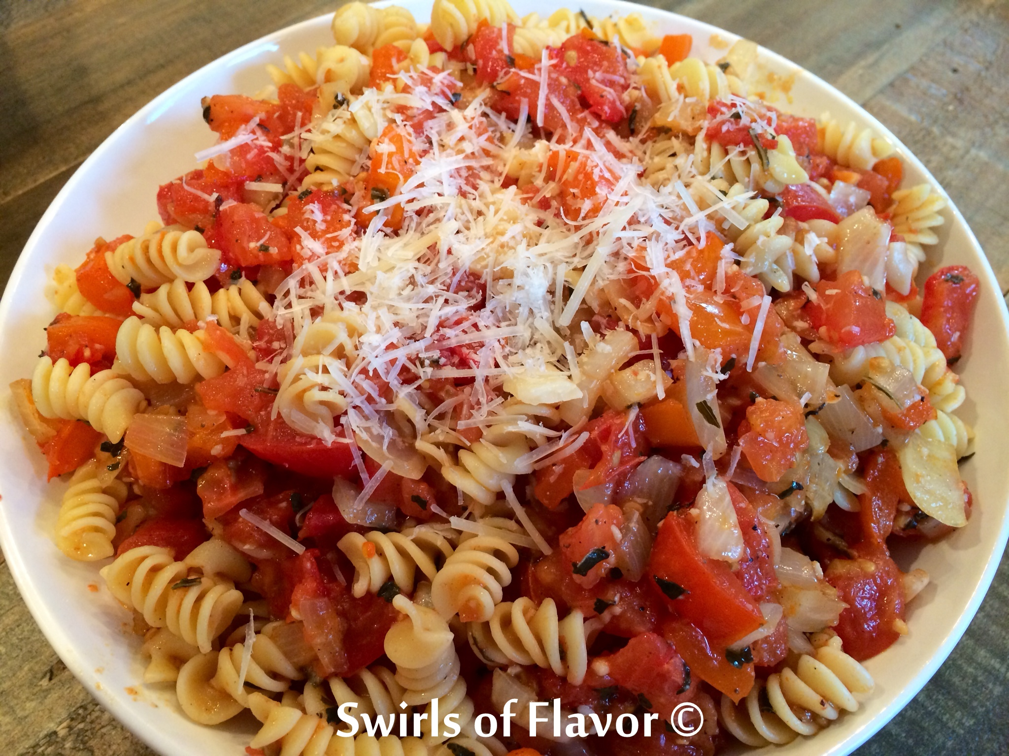 boof pasta with a roasted tomato sauce and cheese