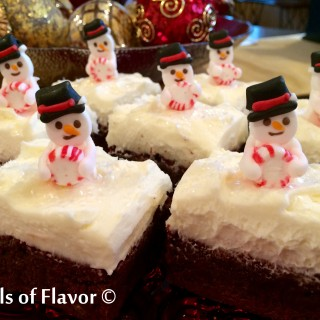 Peppermint Snowmen Brownies is an easy recipe for fudgy homemade brownies topped with a homemade peppermint buttercream frosting and royal icing snowmen. A festive holiday dessert that's fun for kids and grown ups too! #holiday #baking #peppermint #brownies #funforkids #homemadefrosting #Christmas #homemadepeppermintfrosting #homemadebrownies #easyrecipe #dessert #chocolate #swirlsofflavor