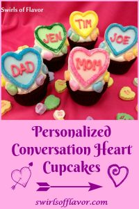 Show someone how much you love them on Valentine's Day with Personalized Conversation Heart Cupcakes. Fondant hearts, decorated with colorful sugars and personalized with names on top of cupcakes will make everyone feel special. Easy to make as an edible craft project both kids and adults will have fun making them! #fondant #hearts #ediblehearts #colorsugar #easyrecipe #craftproject #valentinesday #funforkids #cupcakes #swirlsofflavor