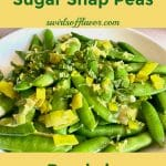 sugar snap peas in white bowl with fresh mint and lemon zest and text overlay