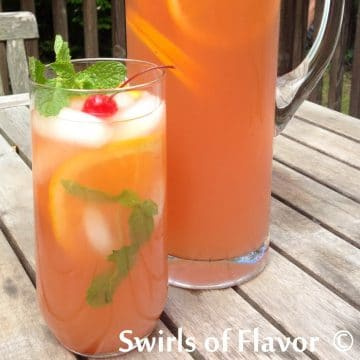 glass of Belmont Jewel punch with frresh mint and marachino cherry