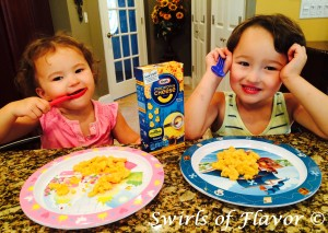 Liam and Emma enjoying Kraft Minions Shapes Macaroni & Cheese!