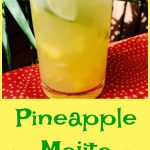 Pineapple Mojito Punch is an easy recipe that takes the traditional Mojito to a tropical paradise with the addition of bits of fresh pineapple and pineapple rum for a refreshing summer drink! #rum #pineapplerum #mojitorecipe #easydrinkrecipe #happyhour #cocktail #summerrecipe #swirlsofflavor