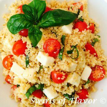 quinoa, tomatoes and mozzarella with fresh basil leaves