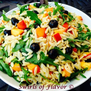 Blueberry Peach Orzo is an easy seasonal recipe filled with lime-kissed orzo pasta and studded with fresh juicy peaches and succulent blueberries. Tender peppery arugula leaves offset the fruity sweetness creating a perfect balance of flavors. side dish | fresh fruit | pasta | orzo | blueberries | peaches | easy recipe | arugula | farmers market | #swirlsofflavor