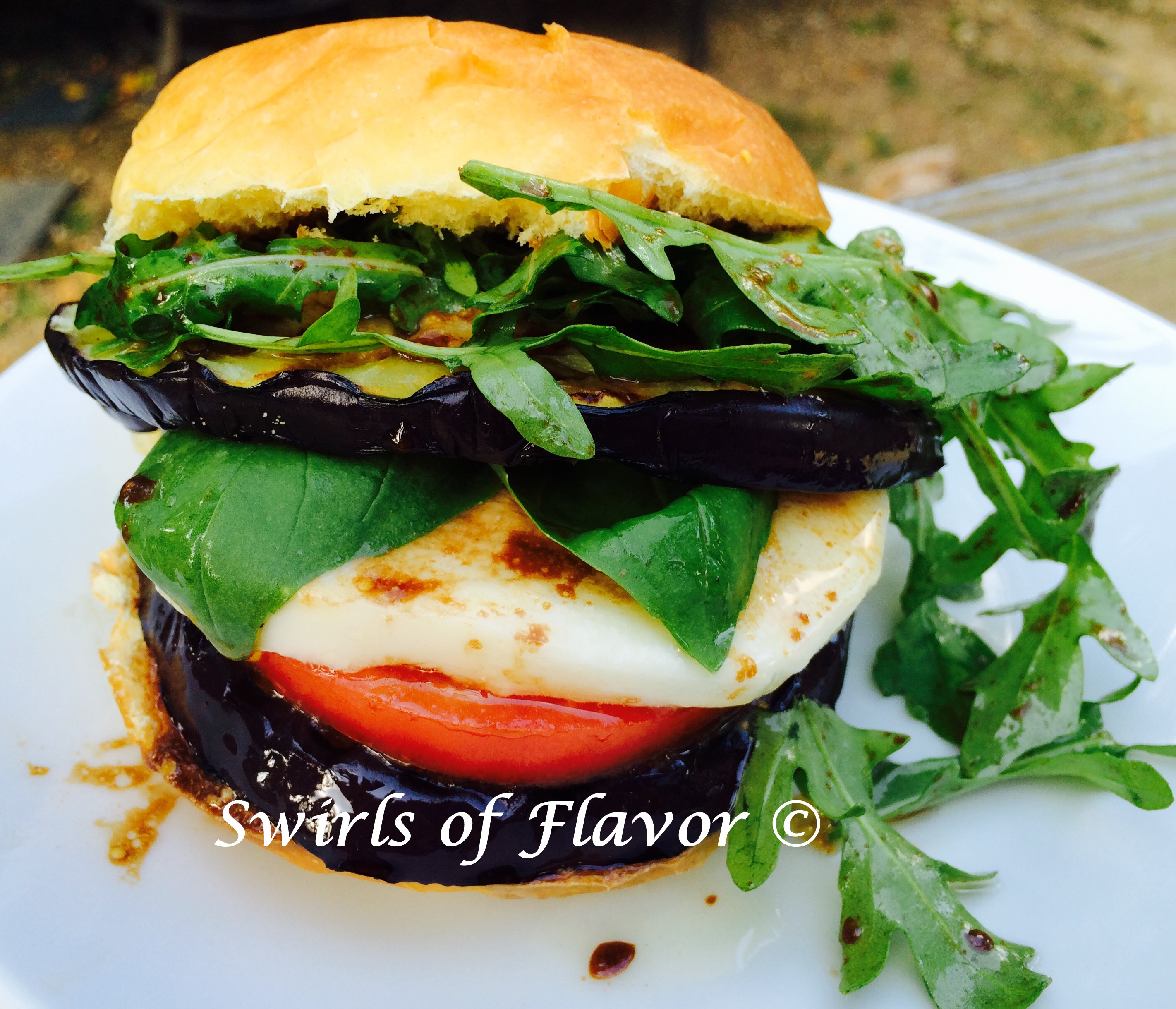Eggplant Caprese Sandwich with fresh mozzarella, arugula and balsamic vinaigrette
