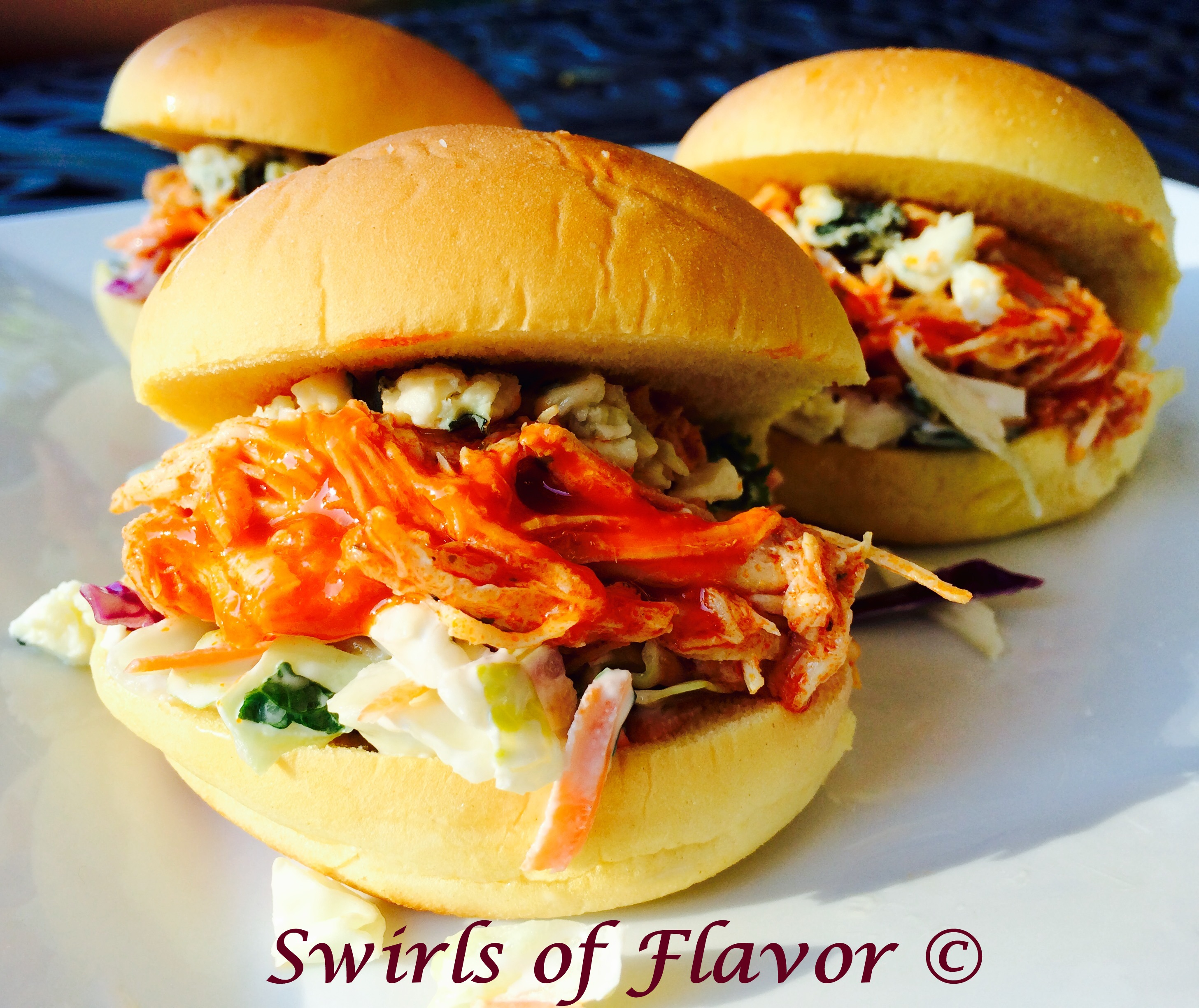 Slow Cooker Buffalo Chicken on buns with cole slaw