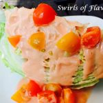 Iceberg lettuce wedge with heirloom tomatoes and creamy dressing