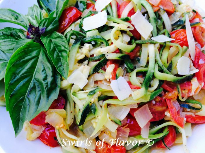 Zucchini Pasta Pomodoro is bursting with the summertime flavors of zucchini noodles, tomatoes and fresh basil. easy recipe | summer | zoodles | farmers market | pasta | vegetarian | Meatless Monday | dinner  #swirlsofflavor