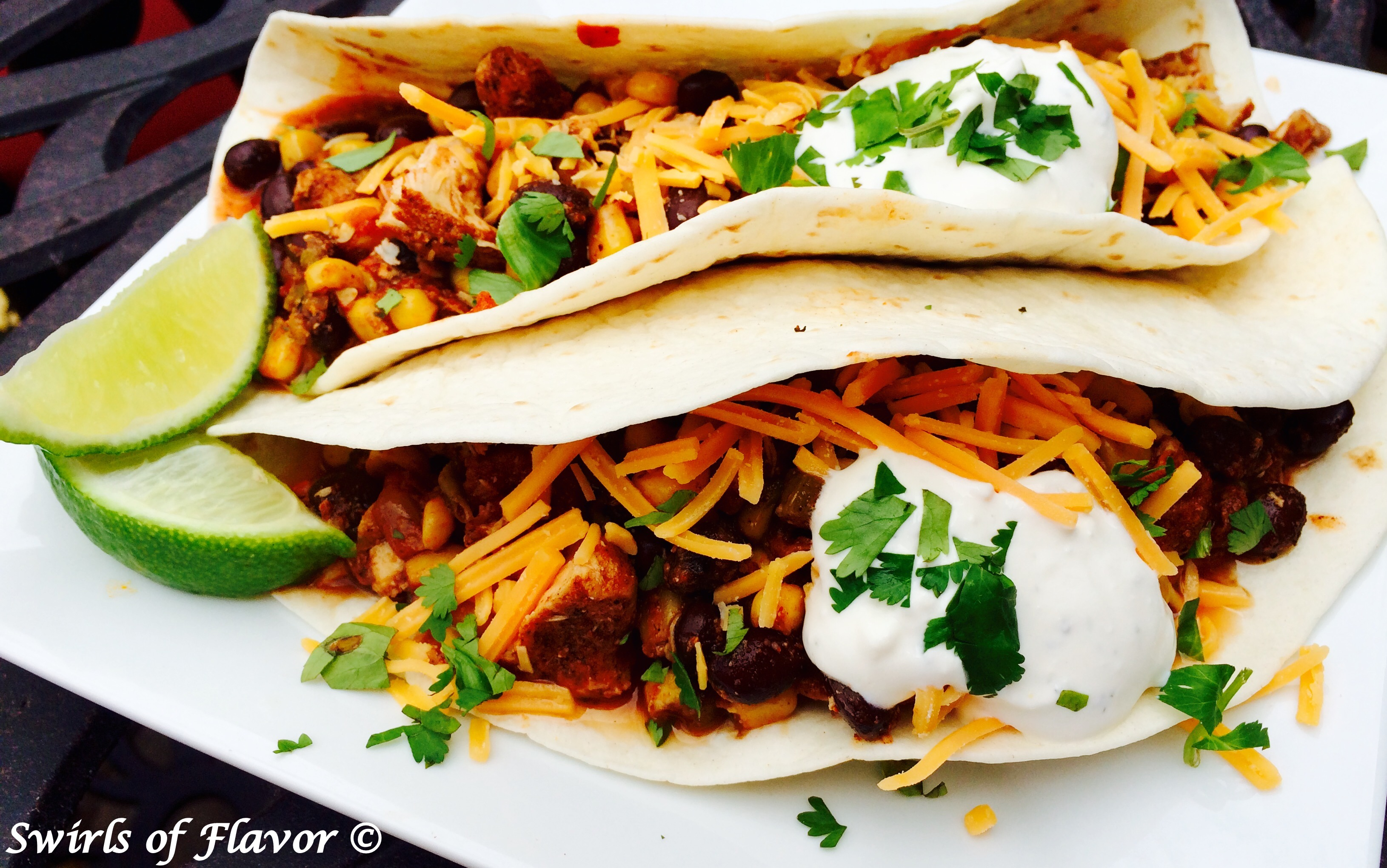 Chicken Chili in tortilla with cheese and sour cream