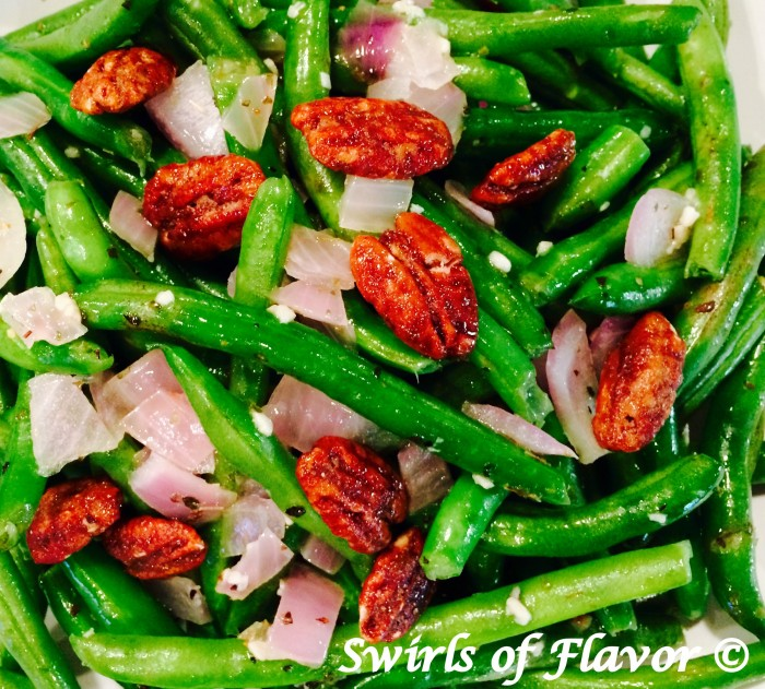 Buttery Green Beans is an easy recipe of fresh green beans sautéed with red onion and garlic, simmered in white wine, tossed with buttery goodness and crowned with glazed pecans. It's time to update your green bean casserole for Thanksgiving with this easy side dish recipe! #greenbeans #freshgreenbeans #sidedish #vegetable #sauteedgreenbeans #holiday #Thanksgiving #Christmas #Swirlsofflavor