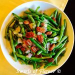 Buttery Green Beans is an easy recipe of fresh green beans sautéed with red onion and garlic, simmered in white wine, tossed with buttery goodness and crowned with glazed pecans. It's time to update your green bean casserole for Thanksgiving with this easy side dish recipe!
