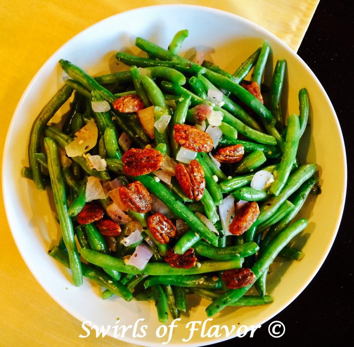 BButtery Green Beans is an easy recipe of fresh green beans sautéed with red onion and garlic, simmered in white wine, tossed with buttery goodness and crowned with glazed pecans. It's time to update your green bean casserole for Thanksgiving with this easy side dish recipe! #greenbeans #freshgreenbeans #sidedish #vegetable #sauteedgreenbeans #holiday #Thanksgiving #Christmas #Swirlsofflavor