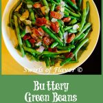 Buttery Green Beans is an easy recipe of fresh green beans sautéed with red onion and garlic, simmered in white wine, tossed with buttery goodness and crowned with glazed pecans.It's time to update your green bean casserole for Thanksgiving with this easy side dish recipe! #greenbeans #freshgreenbeans #sidedish #vegetable #sauteedgreenbeans #holiday #Thanksgiving #Christmas #Swirlsofflavor