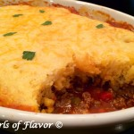 Chili Cornbread Bake is an easy recipe that will certainly become a family favorite. A saucy homemade chili is smothered with a cheesy creamy cornbread topping and baked until hot, bubbly and golden! The perfect comfort food dinner on a chilly evening. #chili #homemadechili #cornbread #bake #casserole #familyfavorite #comfortfood #easyrecipe #dinner #swirlsofflavor