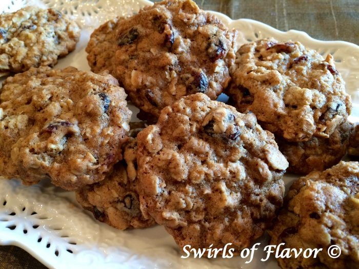 Cranberry Almond Oatmeal Cookies will bring back your childhood memories or warm cookies and milk. Create delicious memories today when you bake up a batch of these cookies! oatmeal | cookies | homemade | cranberry | almond | baking | dessert | fun for kids | classic