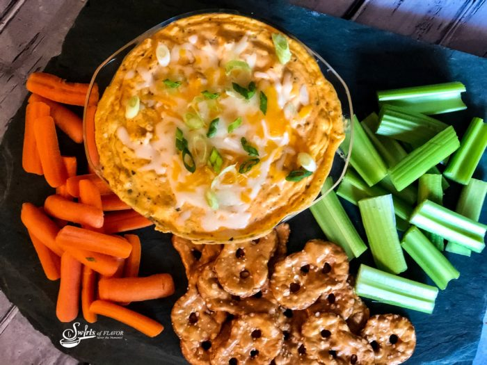 Overhead of Buffalo chicken Dip with dippers