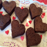 heart shaped brownies on white platter with text overlay