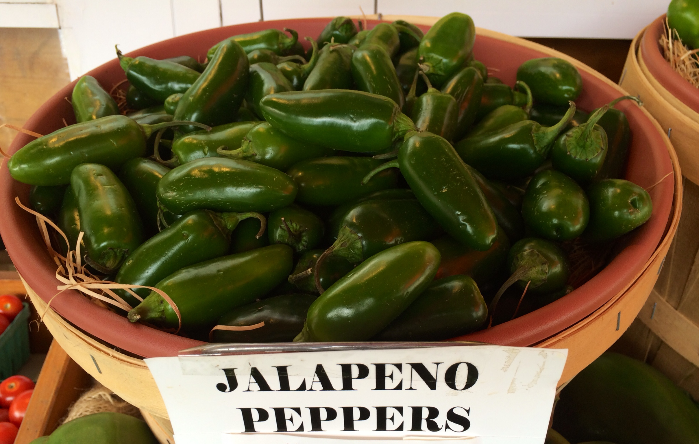 bin of jalapeno peppers