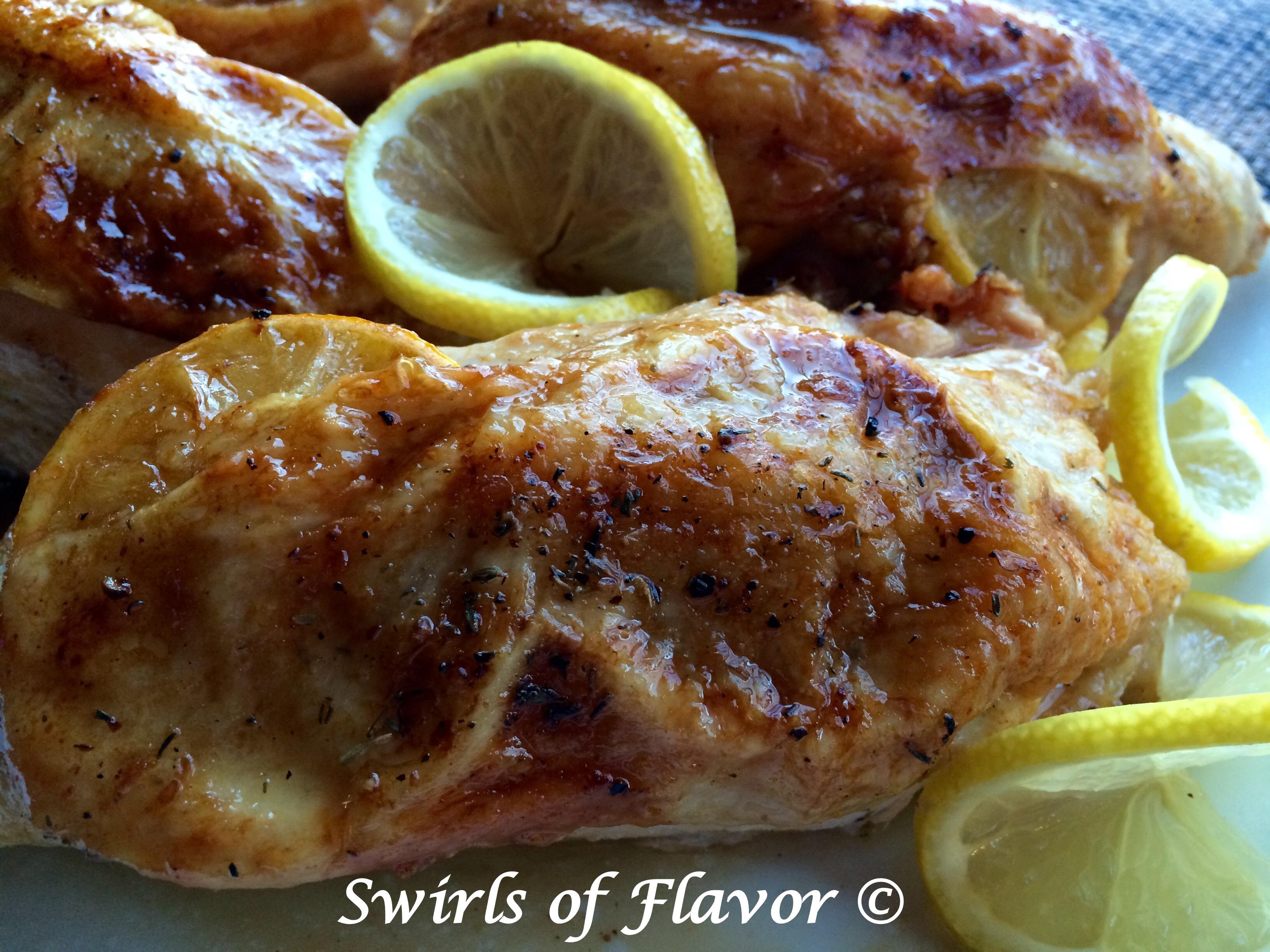 Oven Roasted Lemon Thyme Chicken with lemon slices