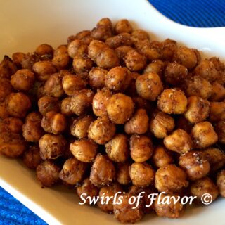 Toss a can of chickpeas with spices and oven-roast until they're crispy! Movie night just got fabulously delicious with Roasted Chili Chickpeas! chickpeas | roasted | snack | crispy
