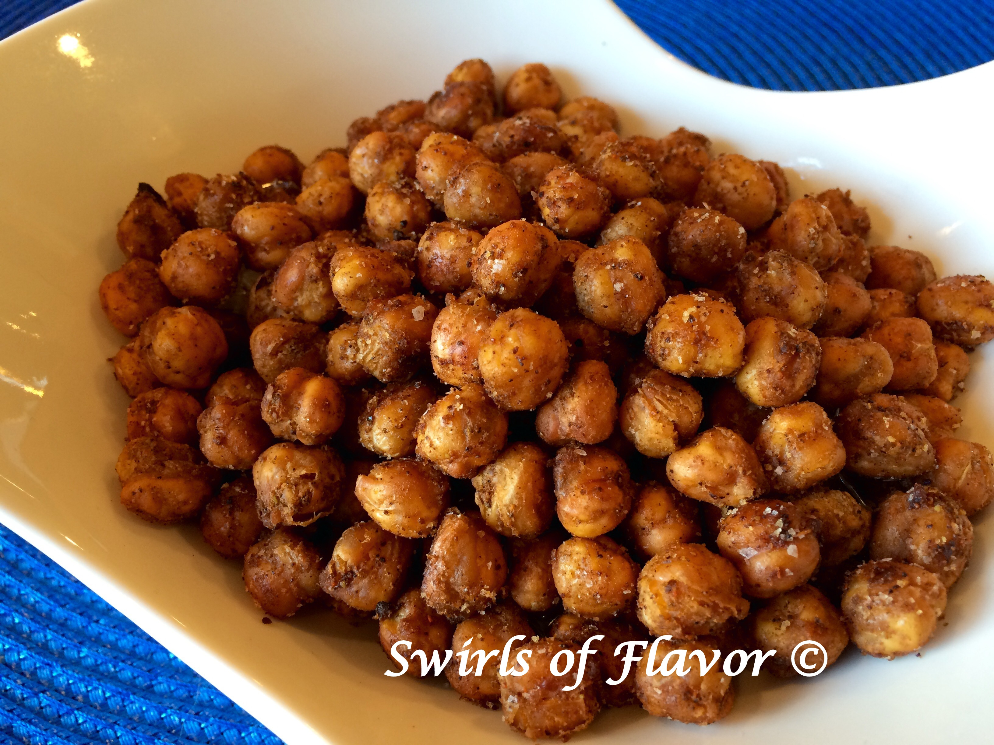 crispy chickpeas with chili seasoning in a whote bowl