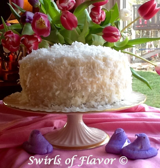 coconut cake with shredded coconut on cake stand
