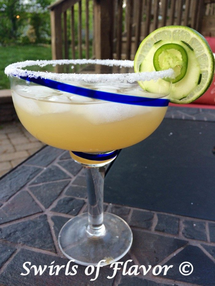 Jalapeno Cucumber Margaritas are a twist on the classic margarita cocktail. Spicy jalapenos and refreshing cucumbers flavor a margarita mixture lending the perfect balance of heat and coolness to our easy margarita recipe.