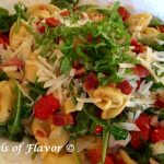 Skillet Tortellini Pomodoro With Pancettain a light buttery garlic white wine sauceis studded with crispy bits of pancetta, sautéed tomatoes and fresh arugula and basil. easy recipe | pasta recipe | dinner | one skillet | #swirlsofflavor