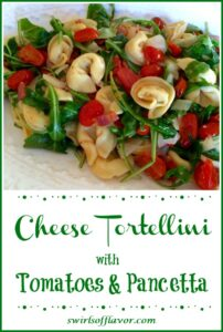 Cheese Tortellini with arugula, tomatoes and pancetta on a white platter