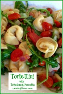 Cheese Tortellini with arugula and tomatoes