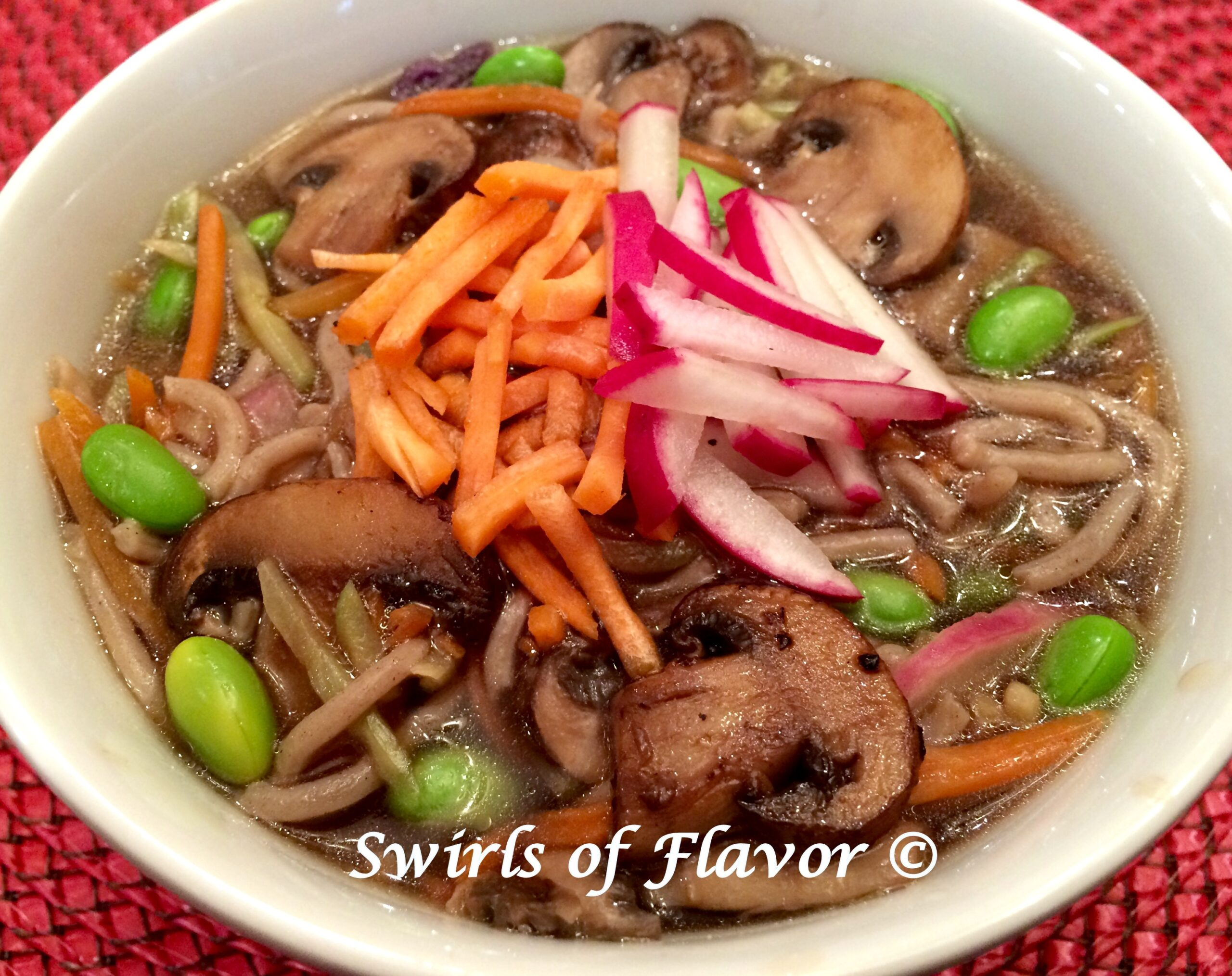 soba noodles and fresh vegetables in a white bowl